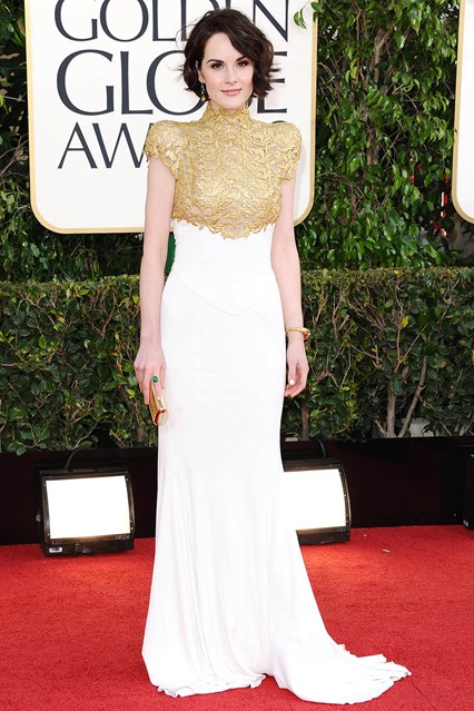 Michelle Dockery Wore an Alexandre Vauthier Couture autumn/winter 2012-13 white gown with gold detailing, accessorized with Bulgari jewelry.